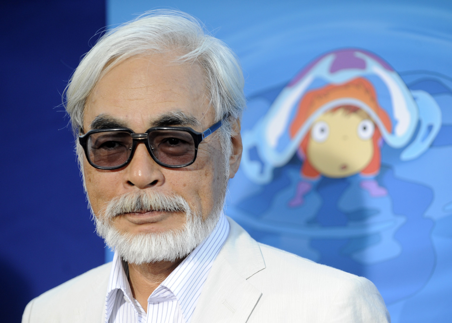 """Hayao Miyazaki of Japan, director of the animated film """"Ponyo,"""" poses at a special screening of the film in Los Angeles, Monday, July 27, 2009. (AP Photo/Chris Pizzello)"""